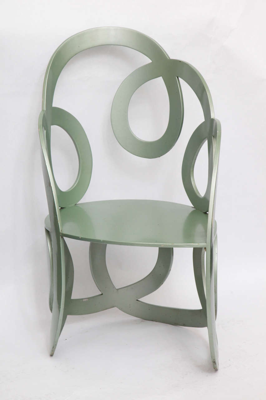 A 1980s sculptural chair crated of painted metal.
