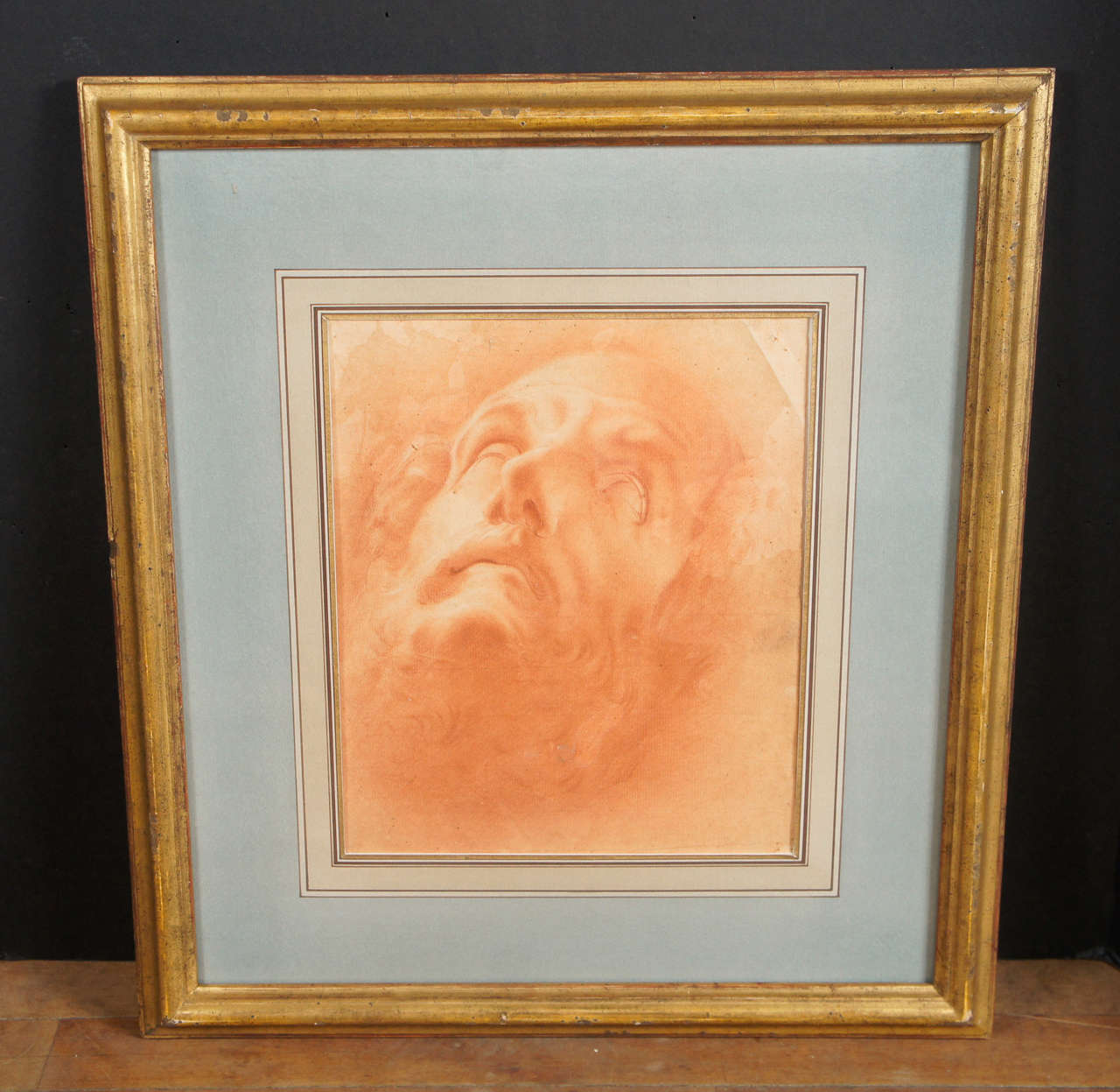 This very fine drawing from the early Baroque period is in Sanguine on laid paper.  this Italian drawing in a rich brown-red is framed in a fine old gilded frame and has a beautiful old french matte. The image of the head of John the Baptist after