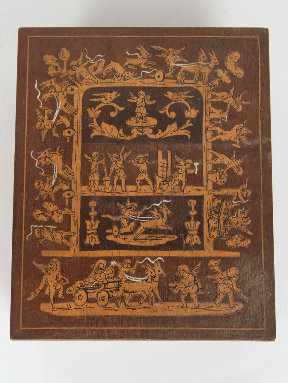 19th century French inlay wooden cigarette box. Finely inlaid with fruit wood. Scenes of cherubs playing.