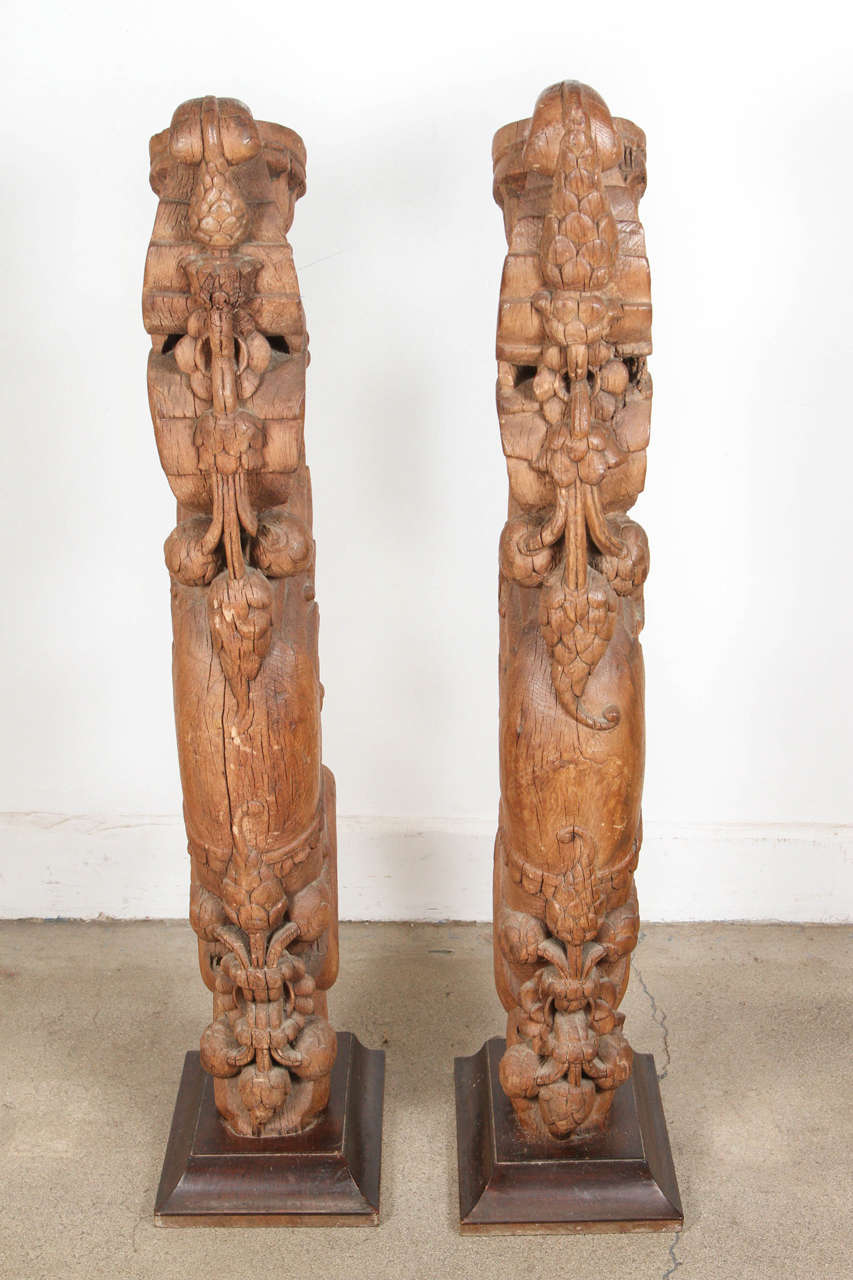 Pair of tall Antique architectural carved wood temple truss fragments from India on stand. Wooden hand-carved fragments architectural truss temple, large and heavy. Measures: Wooden stand is 13