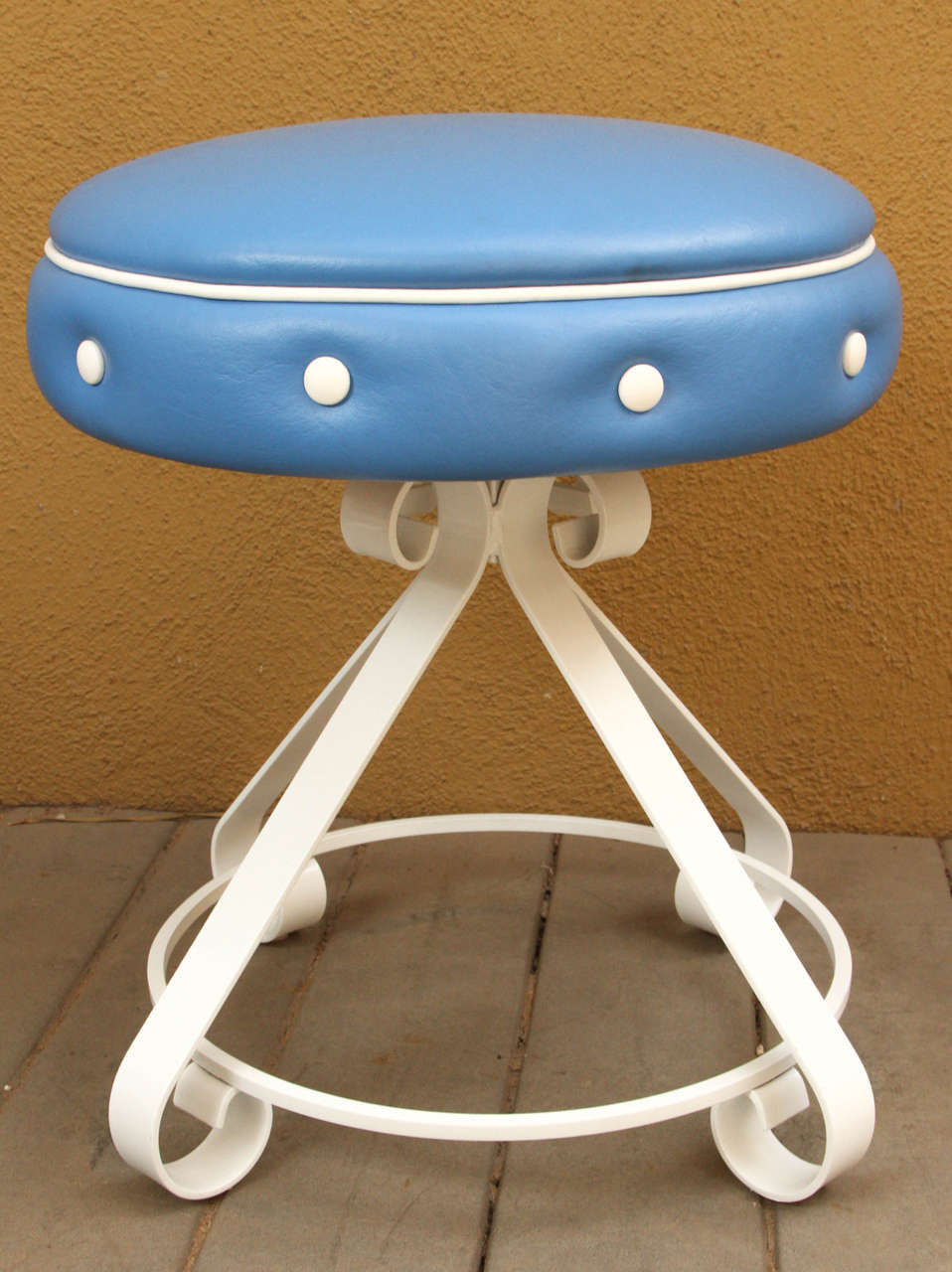 Three Stools With White Metal Bases And Blue Leather