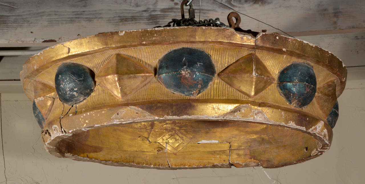 Large circular ciel du lit, or bed corona, circa 1760-1780, with painted and gilded carved detail. Reverse side is unfinished.