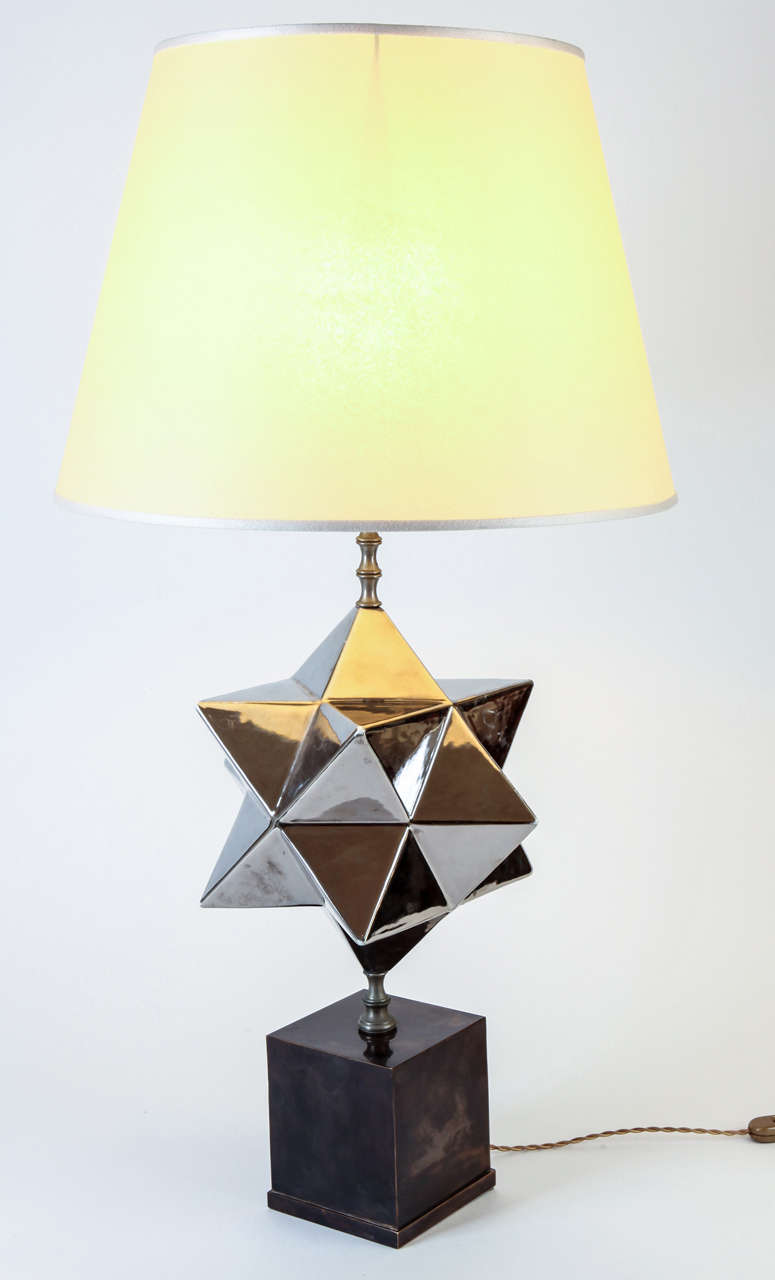 Silvered ceramic by the manufacture Zaccagnini Firenze, base on patined brass. The height is with shade.