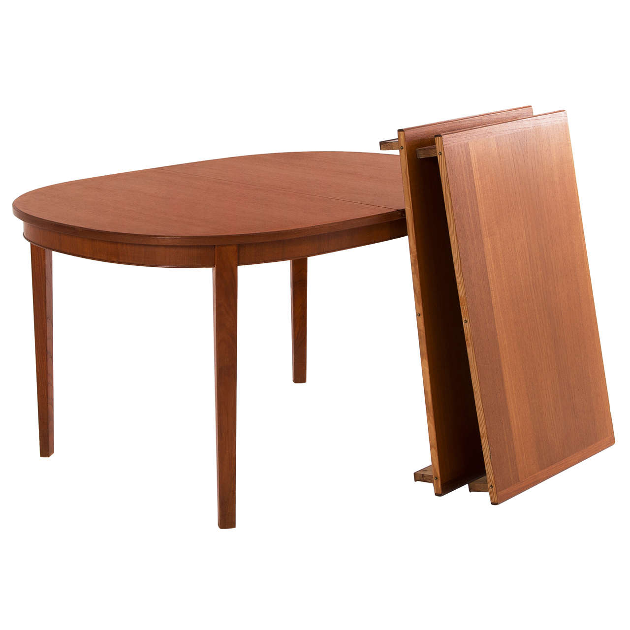 Extendable oval dining table in teak at 1stdibs Oval dining table