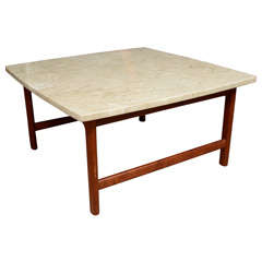 Solid teak coffee table with travertine top, mfg. Dux