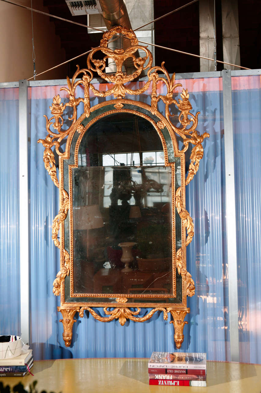 Carved Italian neoclassical giltwood mirror, 18th century.