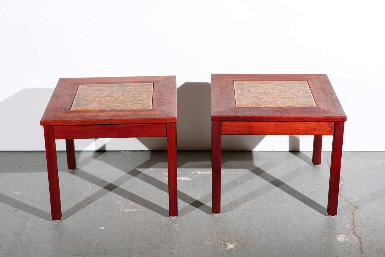 Pair of Brown Saltman teak end tables with 'antique gold' metal enamel tile inlay