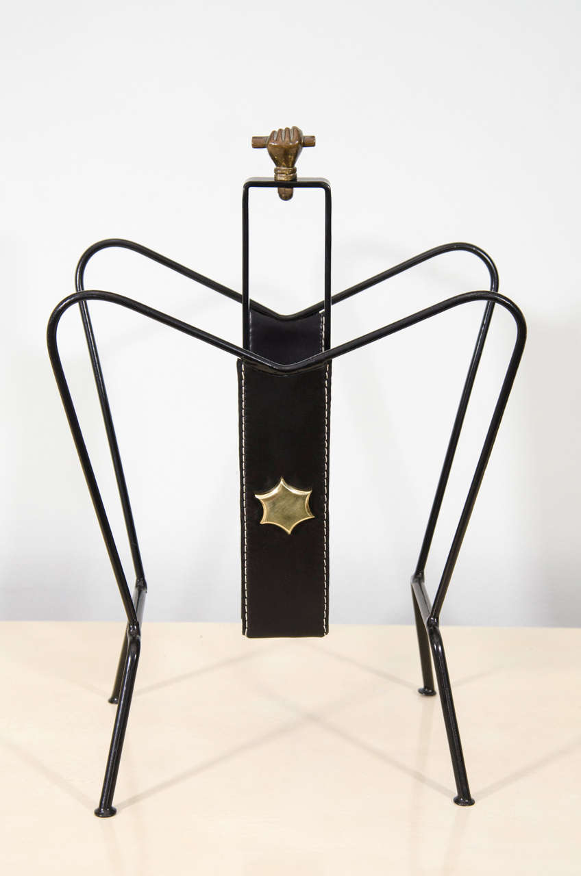 Wonderfully designed magazine holder by Jacques Adnet with leather and bronze details.