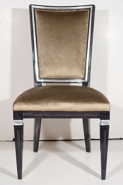 Pair of neoclassical style chairs with Gustavian design in walnut with an ebony finish and with antique silver leaf details. Chairs have an elegant high back design and have been upholstered in a mushroom tone crushed velvet. Perfect as occasional