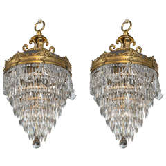 Pair of Bronze and Crystal Drop Chandeliers