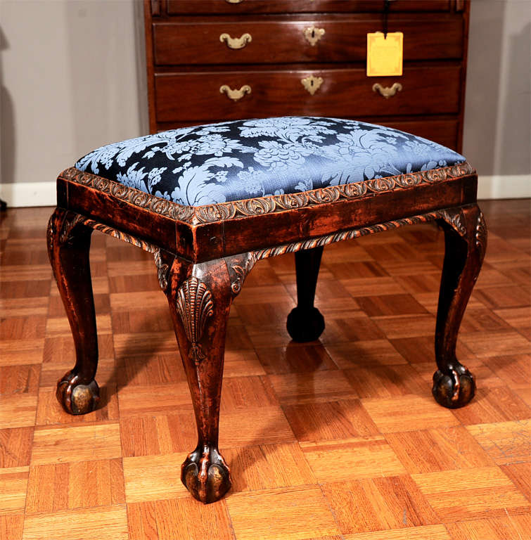 Georgian mahogany stool with shell-carved cabroile legs. With ball-and-claw feet.