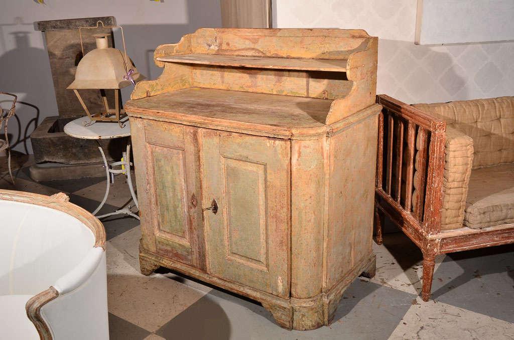Beautiful Swedish buffet, scraped finish to the original paint. Unusual top shelf. Two simple carved doors, circa 1780.