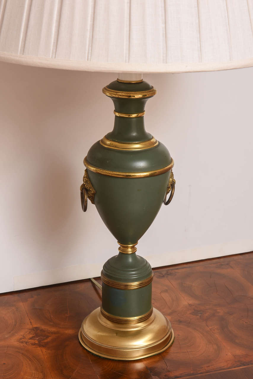 Pair Of French Green And Gilt Urn Form Tole Lamps For Sale