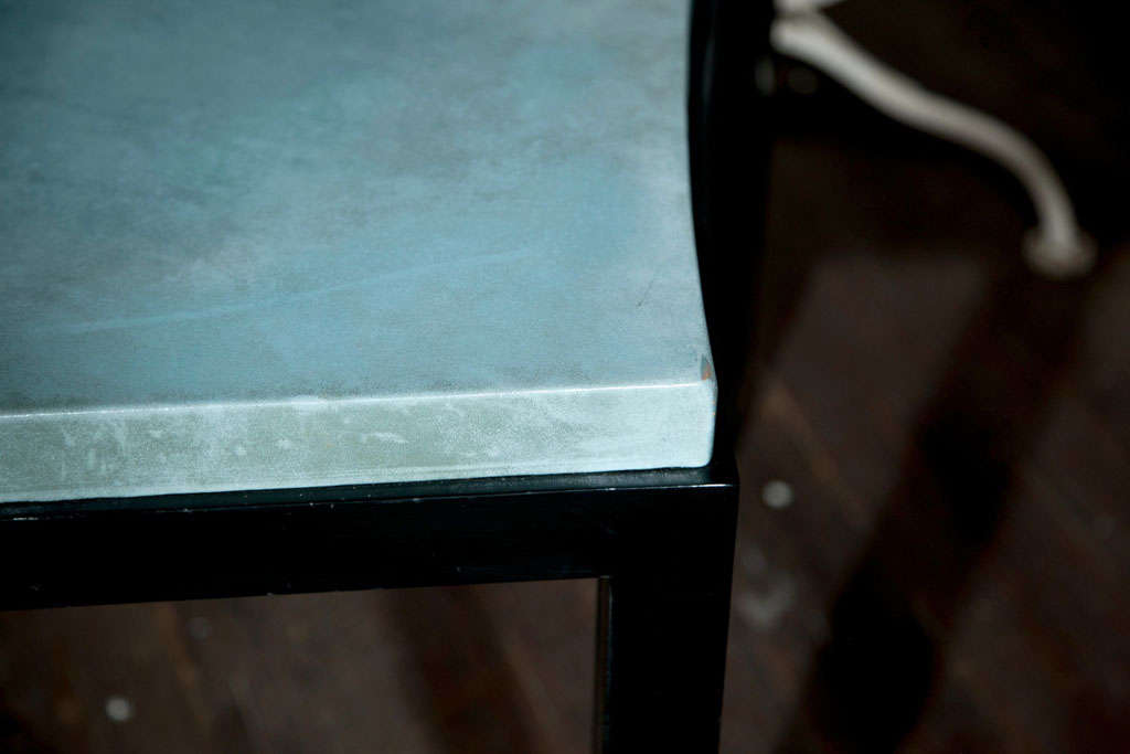 Curved black parson's style table with a beautiful blue leather top.