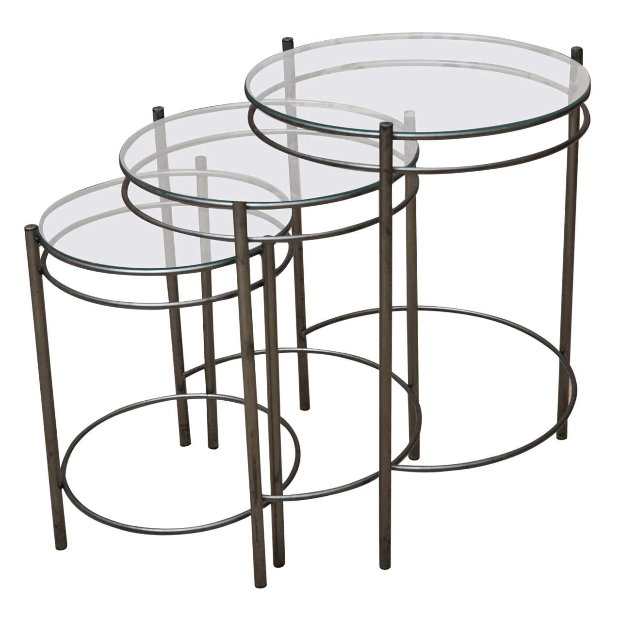 Set of three metal and glass round nesting tables at stdibs