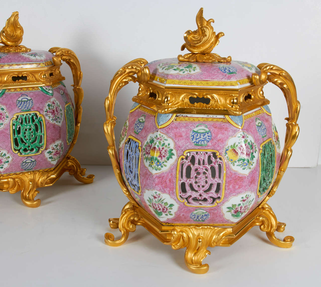 A very fine pair of antique Chinese porcelain and Louis XV-Louis XVI transitional, French doré bronze mounted covered potpourri/urns. These beautiful and quite decorative covered vases are truly spectacular in person and pretty large in scale. The