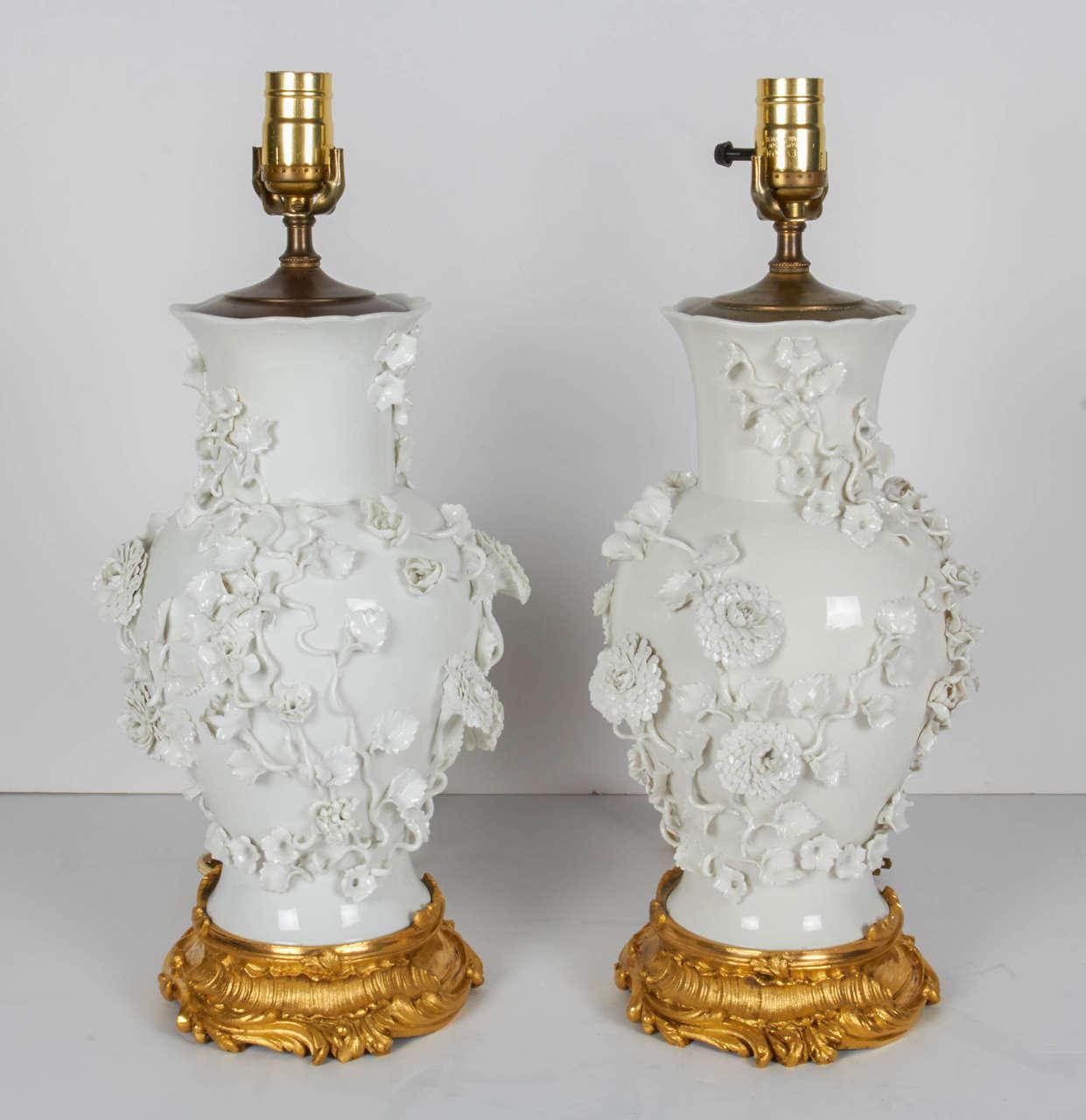 Pair Of Antique Blanc De Chine Porcelain Lamps With Raised