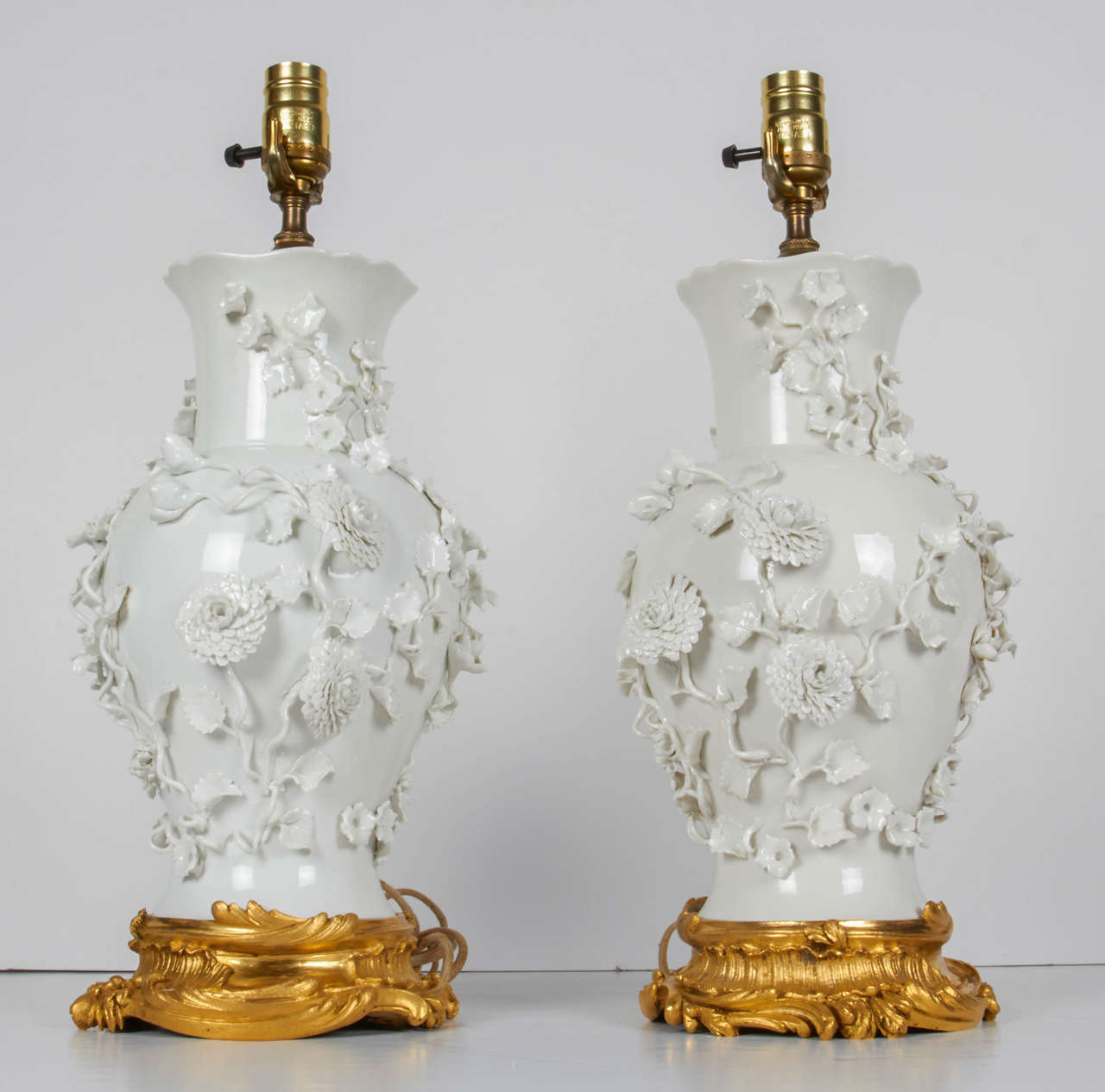 Pair Of Antique Blanc De Chine Porcelain Lamps With Raised