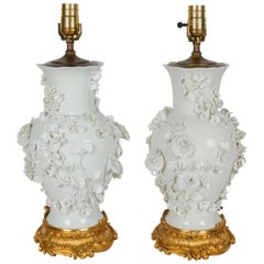 Pair of Antique Blanc de Chine Porcelain Lamps with Raised Flowers