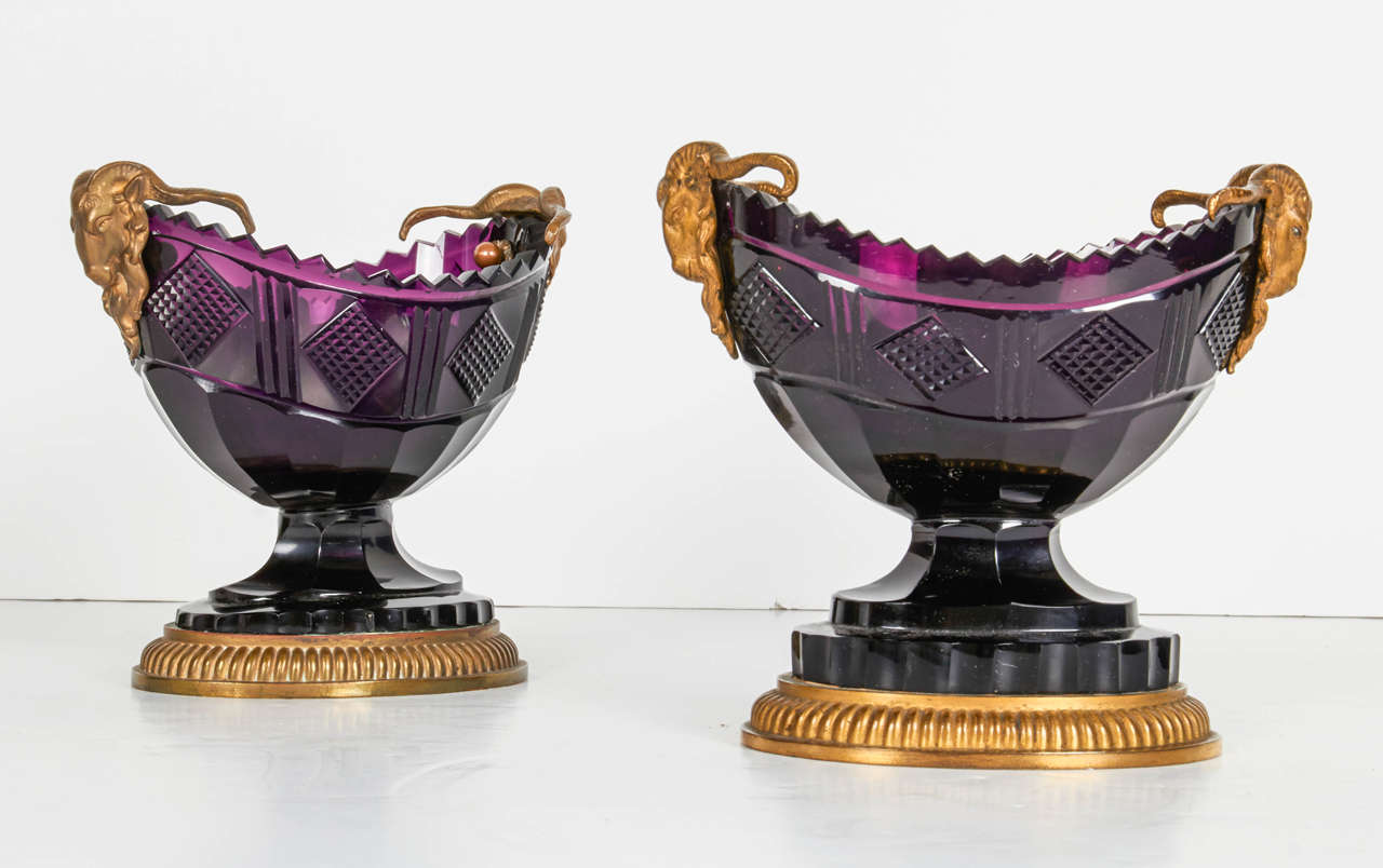 A fine pair of antique Russian ormolu and amethyst cut-glass compotes, 19th century. This pair of navette-shaped bowls cut with lozenge pattern and flanked by ram's masks on a gadrooned plinth. They were must probably made by the Russian Imperial