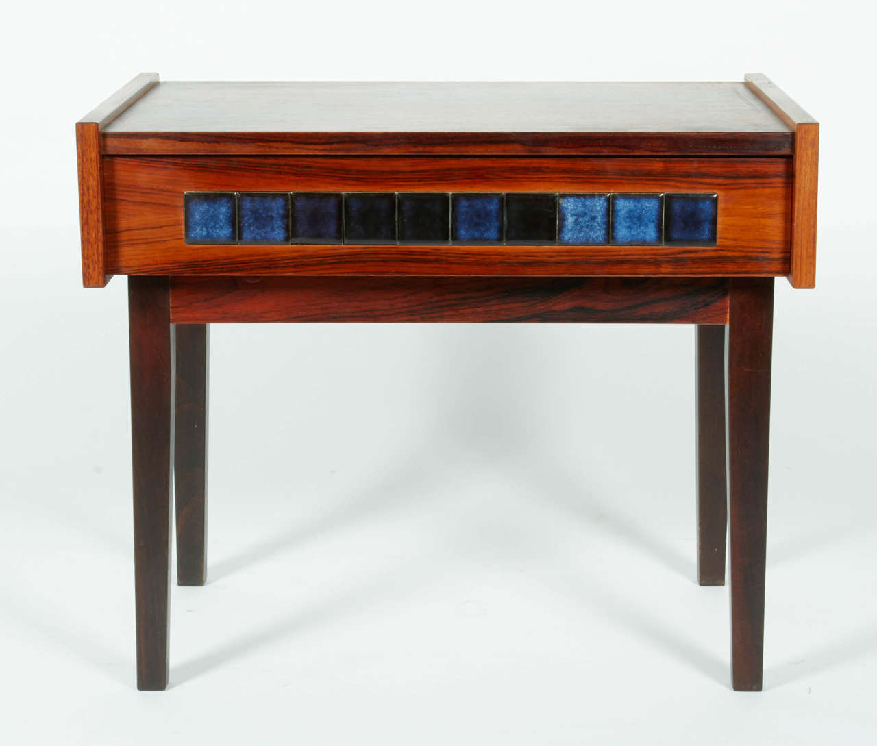 An attractive side table in rosewood featuring square tiles in array of blue.