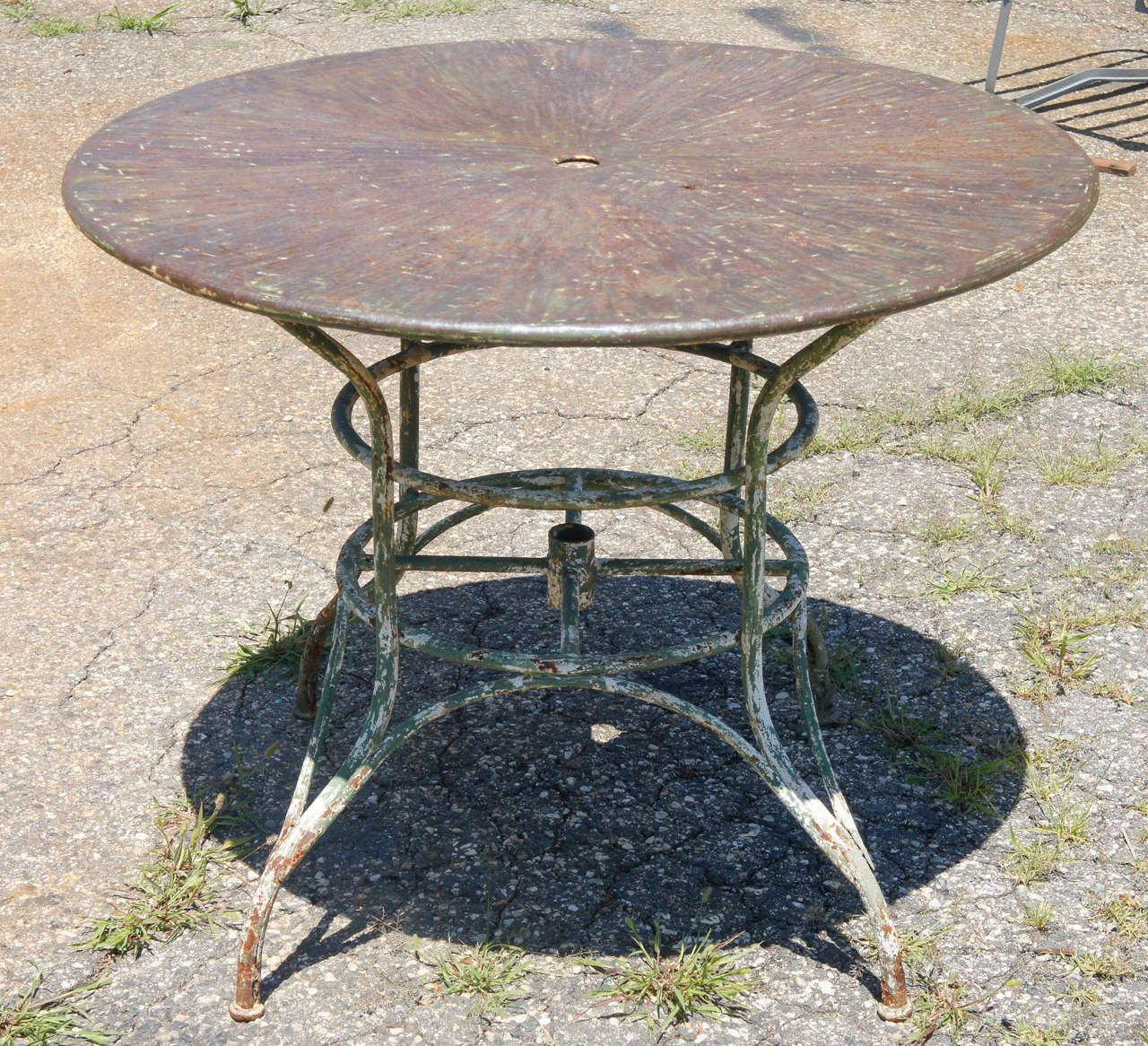An Unique Indoor Or Outdoor Round Metal Garden Umbrella Table With Surface  Of Colors Splayed From