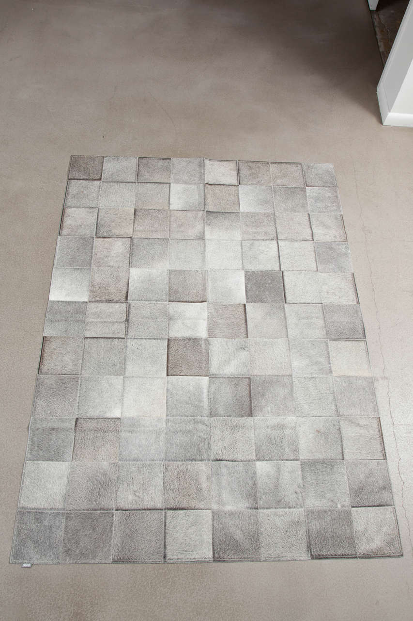 This Pure Exotic Zebu patchwork cowhide rug is sewn together by Brazilian craftsman. Pure's cowhides originate from the Pampas Grasslands of Brazil, all individually selected for their superior quality, shine and softness. Then each patchwork rug is