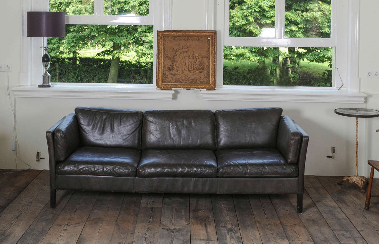 A 1960s Danish three-seat vintage design sofa with black leather upholstered, by Mogens Hansen.