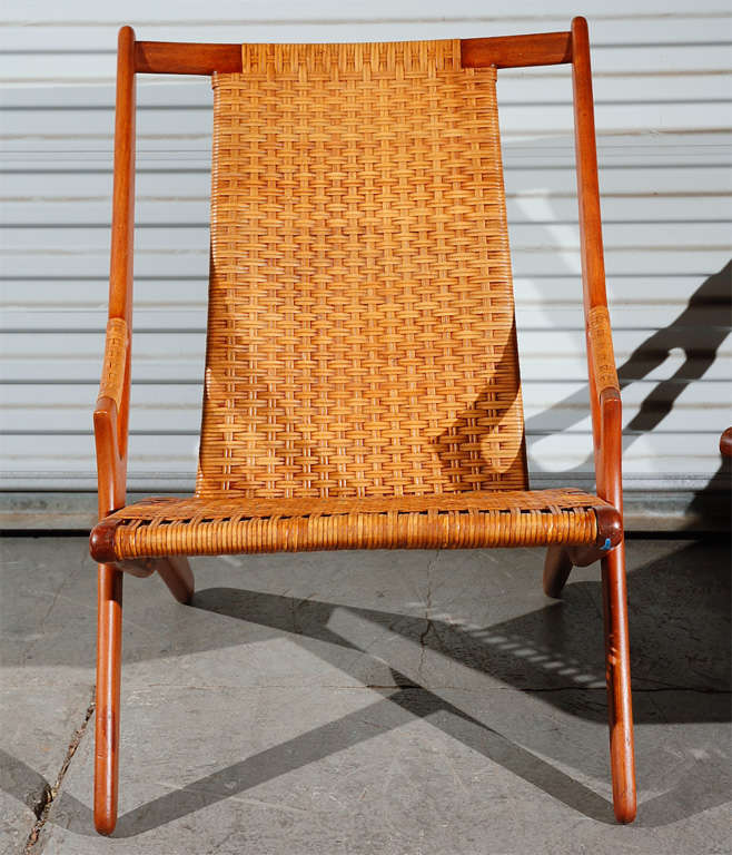 Pair of Arne Hovmand-Olsen teak easy chairs, with back and seats in woven cane.