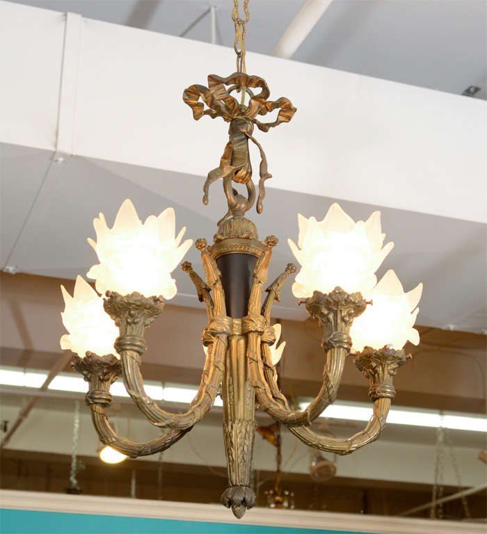 A Vintage French Chandelier In Patinated Bronze With Five Lights Each Frosted Glass Shade Is