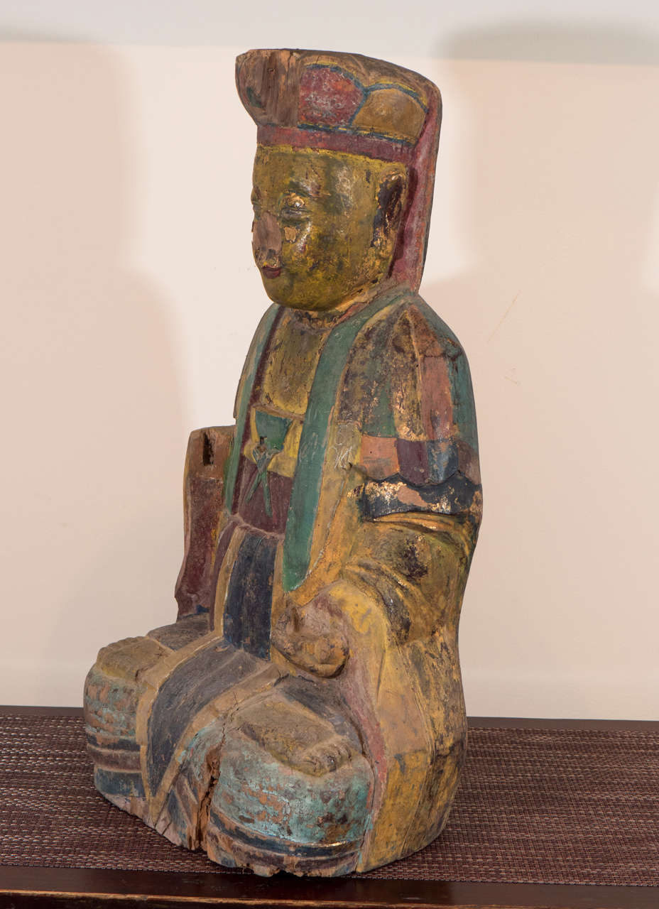 An unusual 18th century wooden Chinese seated Buddha. Beautiful muted colors. With a serene face and great presence. From Shanxi province, circa 1700.