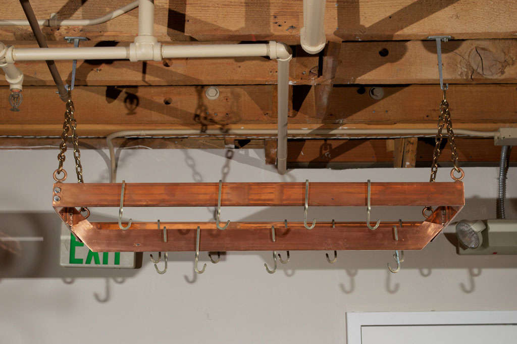 Attractive metal copper plated hanging pot rack with copper plated chain and 13 hooks.