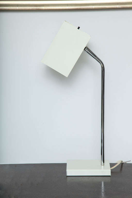 Cube white desk lamp with chrome stem by Robert Sonneman, USA, circa 1970. Adjustable, pivoting shade with on/off switch. Newly rewired for USA with French black silk twist cord; takes one standard bulb, 60 watts max. 