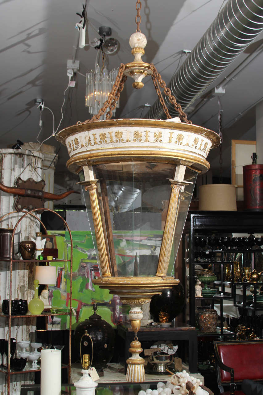 Fabulous oversize Italian 6 ft tall lantern in gilt and worn white. Large candle pricket, but could be easily electrified if you chose to. Grand scale and lovely patina, impressive in person. Good indoors or outside in protected area. Glass panels