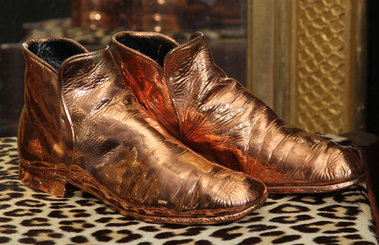 Copper-plated vintage men's boots.