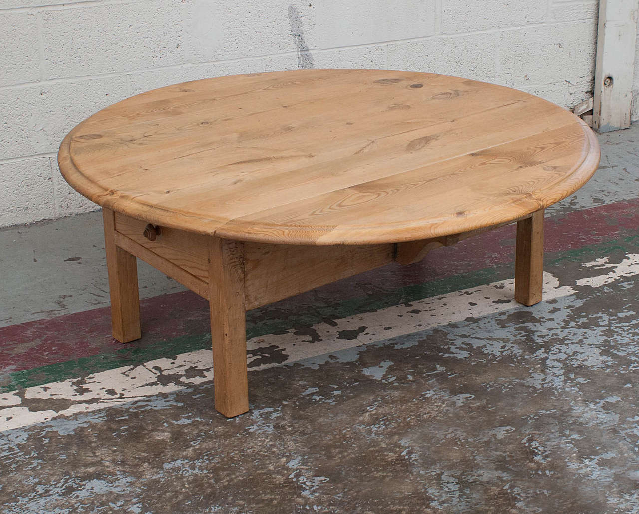 A Pine Drop Leaf Table Cut Down To Coffee Height Featuring Straight Legs