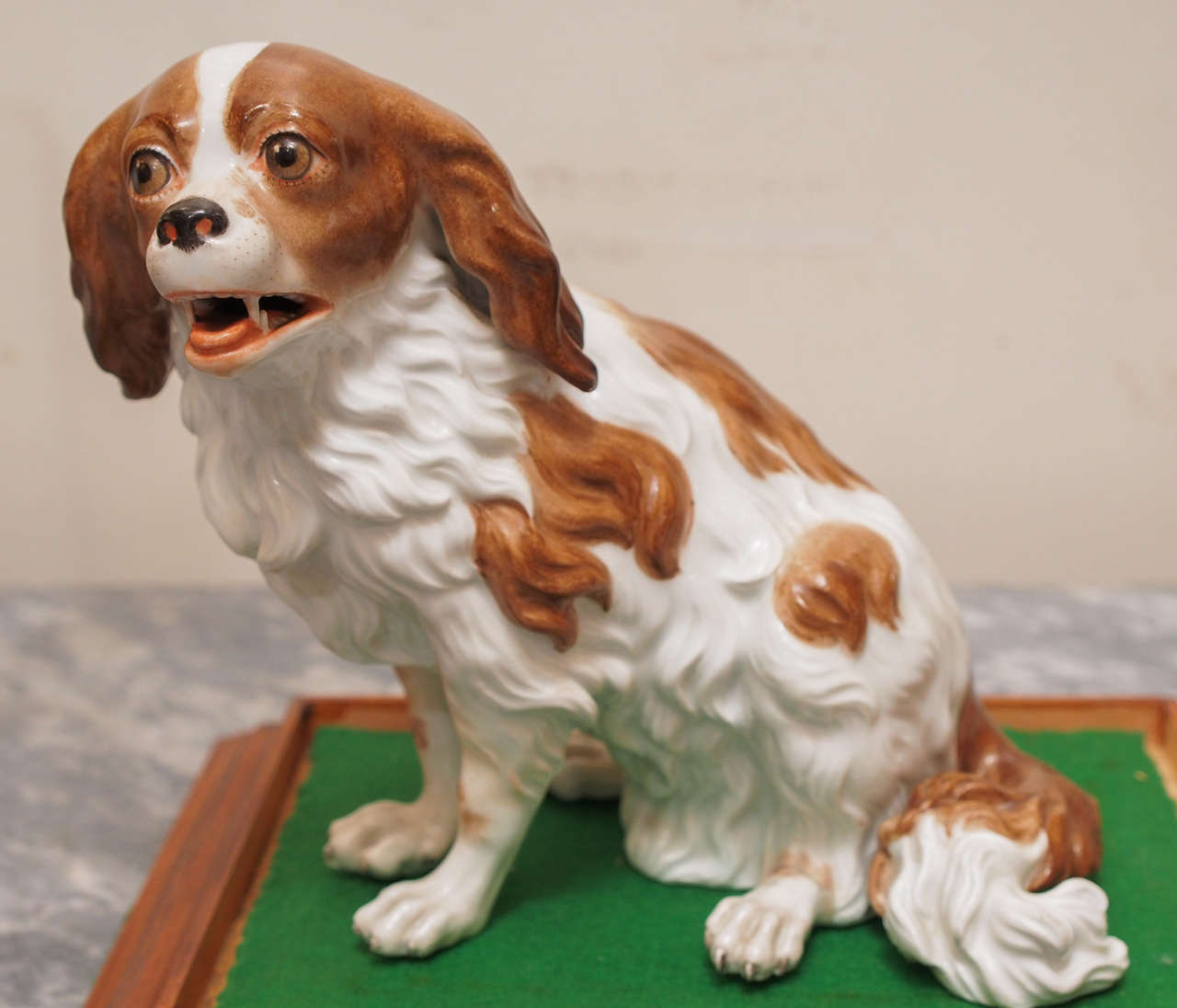 Vienna Porcelain figure of Cavalier King Charles Spaniel with beehive mark now ensconced in a custom glass and copper box with a wooden base.