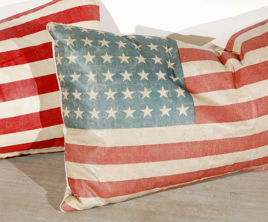 FANTASTIC OIL CLOTH MATERIAL FLAG PILLOWS WITH HOMESPUN LINEN BACKING AND A ZIPPER FOR REMOVING DOWN AND FEATHER INSERTS.THE CONDITION ARE GOOD WITH SLIGHT FADING .SOLD INDIVIDUALY AT 175. EACH.