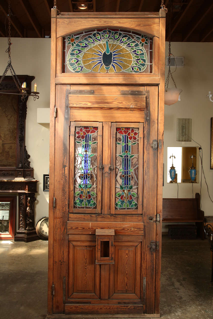 Heart pine entry door with stained glass windows peacock for Entry door with transom