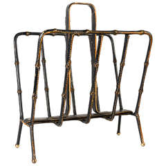 Book Rack by Jacques Adnet