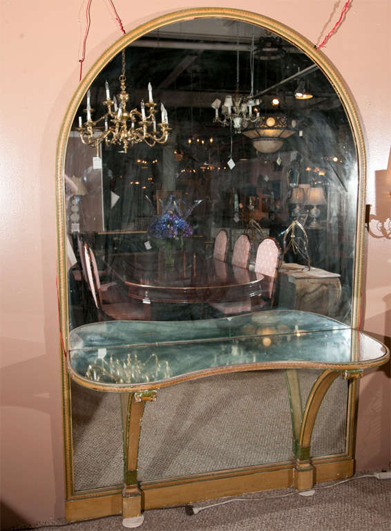 French Louis XVI style vanity, polychromed frame, circa 1940s, domed mirror with a serpentine console attached, supported by two pedestals. By Maison Jansen.