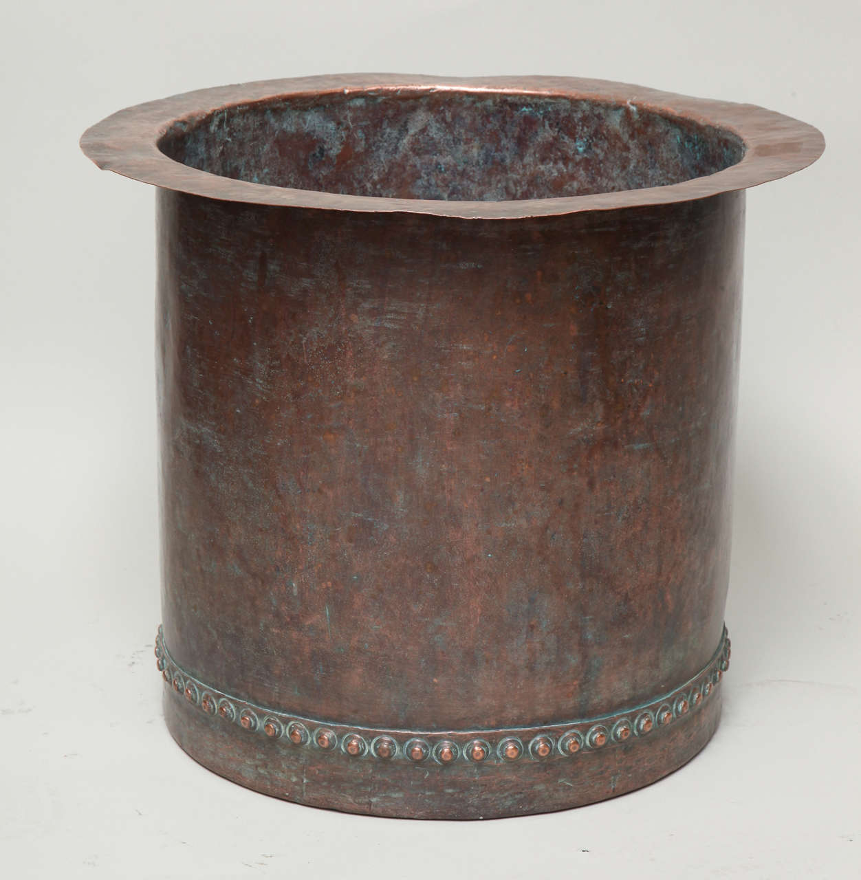 A fantastic riveted copper oversize log bin having beautiful bronzed patina, England, early 19th century.