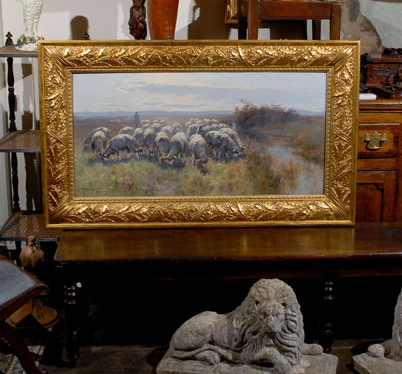A Swedish pastoral oil on canvas sheep painting created by Swedish artist Friedrich Rudolph von Frisching (1833-1906), set inside a giltwood frame. This exquisite Swedish painting of horizontal format features a flock of sheep peacefully grazing