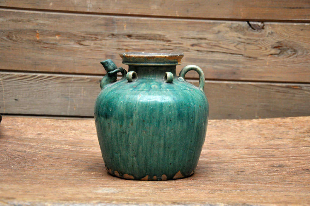 Green glazed tea pot from China's Qing Dynasty.  Probably used in a restaurant.