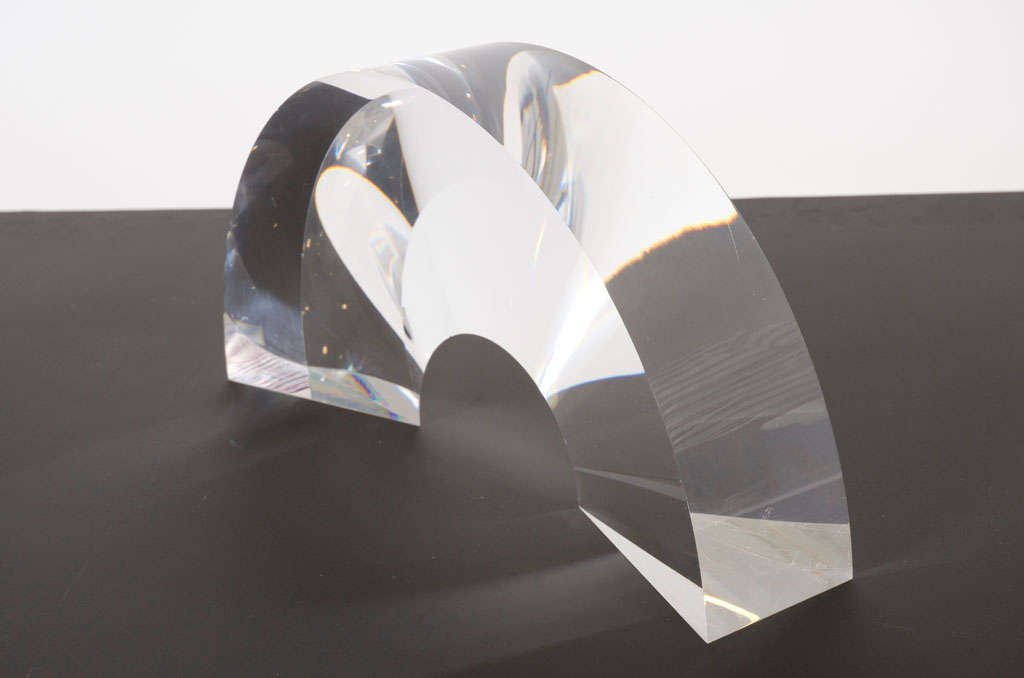 A prismatic acrylic sculpture in the form of an arch that tapers inward creating a three-dimensional effect. By Alessio Tasca, Italian, circa 1970.