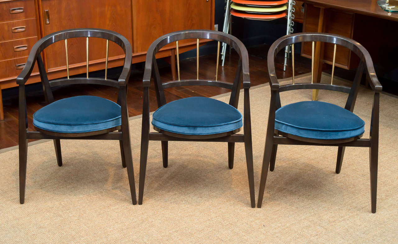 Set of three Edward Wormley design armchairs for Dunbar Furniture Company. Smart and sophisticated armchairs completely refinished and newly upholstered in velvet.  Sold individually for $1800.00 each.