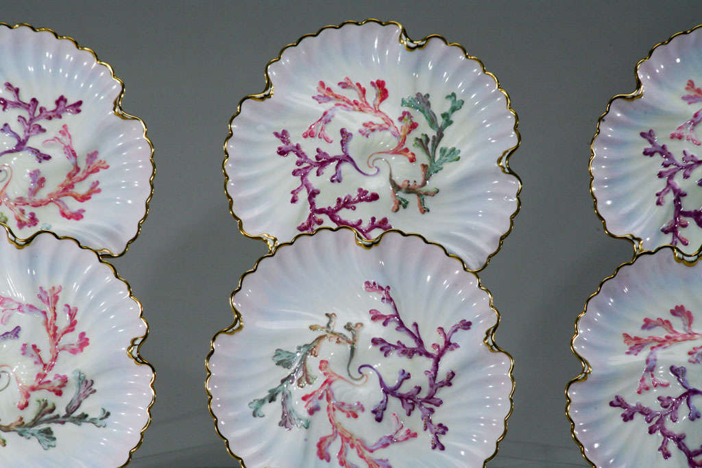 """Wonderful rare set of six """"Aesthetic Movement"""" hand-painted oyster plates, made by Spode and retailed by Tiffany and Company. The fabulous shaded soft pink ground shaded to lavender with gold trim and polychrome enamel decoration over"""
