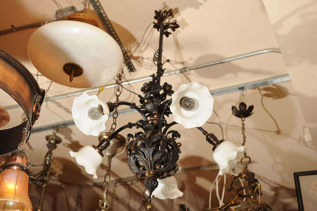 A very nice example of the French Belle Époque period with curly metal and floral themes which highlight this whimsical chandelier.