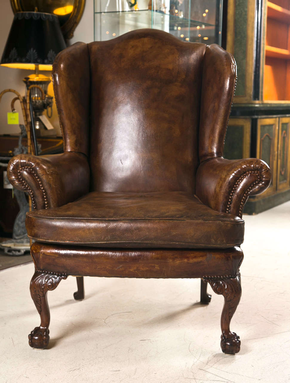 Late 19th C Leather Wingback Chair With Ball And Claw Feet