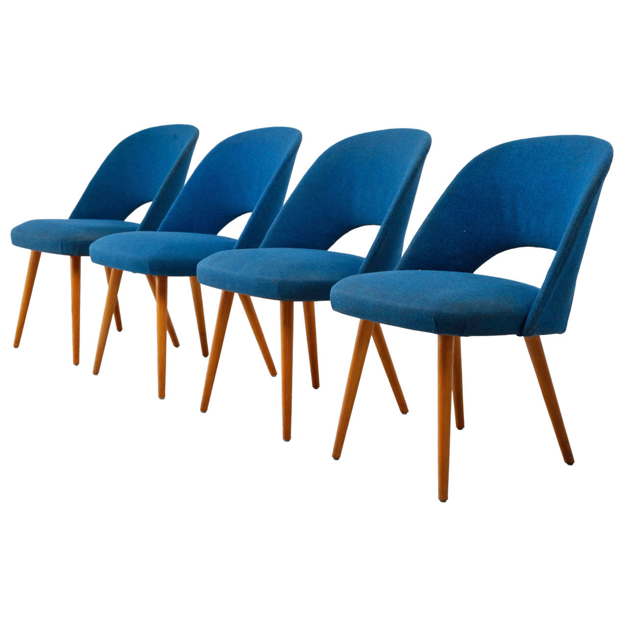 a set of four mid century modern chairs made by thonet